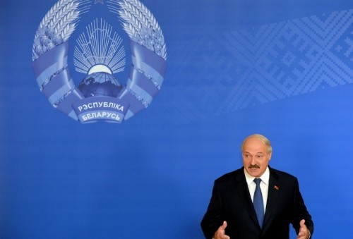 Belarus' President Alexander Lukashenko speaks with journalists during presidential elections at a polling station in Minsk on October 11, 2015. Belarus holds an election that is likely to see authoritarian President Alexander Lukashenko claim a fifth term, with the EU possibly lifting sanctions against him if the polls take place without incident. AFP PHOTO / MAXIM MALINOVSKY